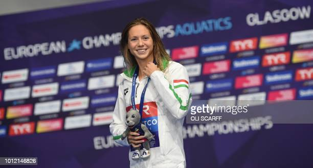 Gold medallist Hungary's Boglarka Kapas poses on the podium during the medal ceremony for the Women's 200m butterfly swimming final at the Tollcross...