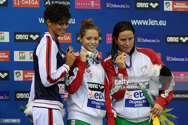 Gold medallist Hungary's Boglarka Kapas silver medallist france's Coralie Balmy and bronze medallist Hungary's Eva Risztov pose on the podium after...