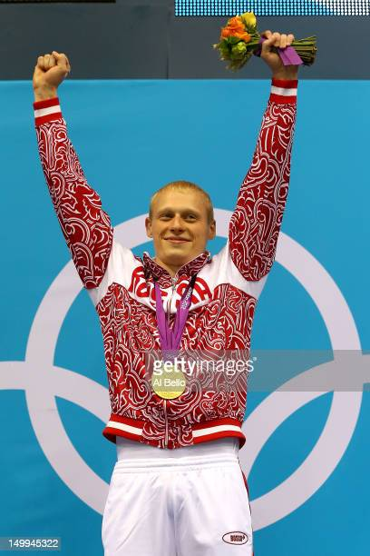 Gold medallist Illya Zakharov of Russia celebrates on the podium during the medal ceremony for the Men's 3m Springboard Diving Final on Day 11 of the...