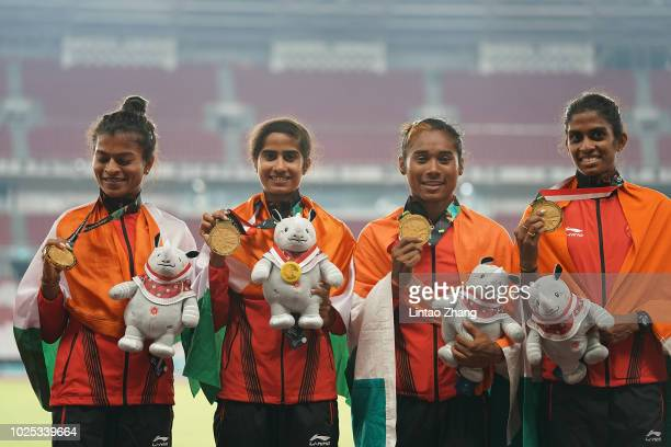 Gold medallist India team celebrate during the medal ceremony for the women's 4x400m relay on day twelve of the Asian Games on August 30 2018 in...