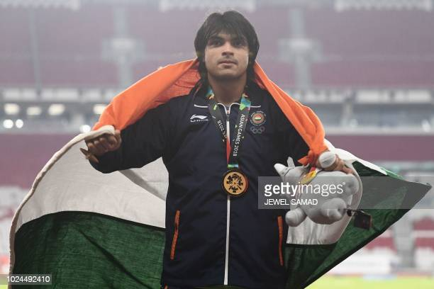 Gold medallist India's Neeraj Chopra celebrates during the victory ceremony for the men's javelin throw athletics event during the 2018 Asian Games...