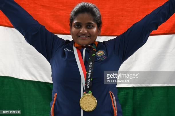 Gold medallist India's Rahi Jeevan Sarnobat poses for pictures after the victory ceremony for the women's 25m pistol shooting final during the 2018...