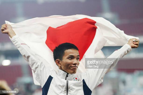 Gold Medallist Inoue Hiroto of Japan celebrates during Men's Marathon medal ceremony on day seven of the Asian Games on August 25, 2018 in Jakarta,...