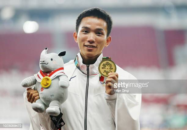 Gold Medallist Inoue Hiroto of Japan poses for photo during Men's Marathon medal ceremony on day seven of the Asian Games on August 25, 2018 in...