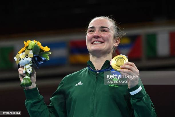 Gold medallist Ireland's Kellie Anne Harrington celebrates on the podium during the victory ceremony for the women's light boxing final bout during...