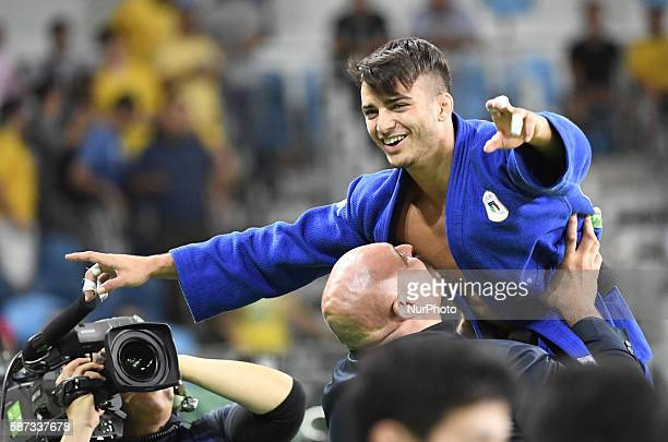 Gold medallist Italy's Fabio Basile celebrates after the men's 66kg judo final at the Rio 2016 Olympic Games in Rio de Janeiro on Aug 7 2016/ CHINA...