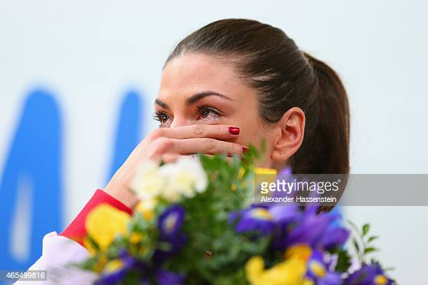 Gold medallist Ivana Spanovic of Serbia shows her emotion on the podium during the medal ceremony for the Women's Long Jump during day two of the...