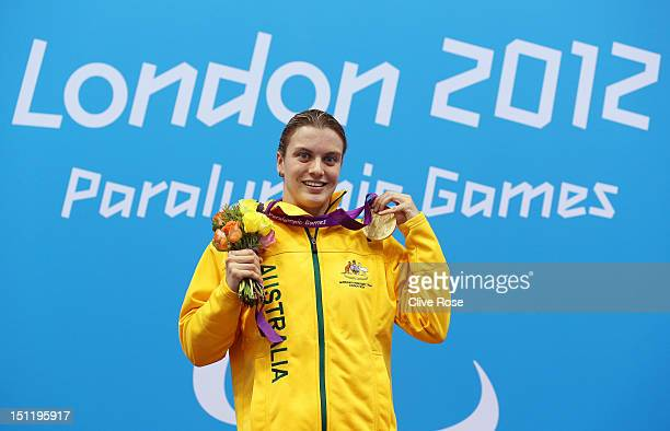 Gold medallist Jacqueline Freney of Australia poses on the podium during the medal ceremony for the Women's 100m Freestyle S7 final on day 5 of the...
