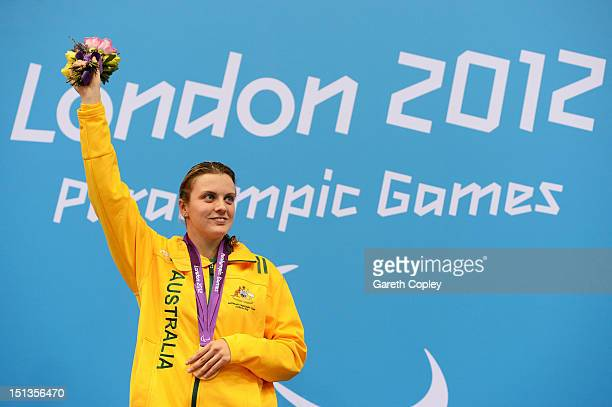 Gold medallist Jacqueline Freney of Australia poses on the podium during the medal ceremony for the Women's 400m Freestyle S7 final on day 8 of the...