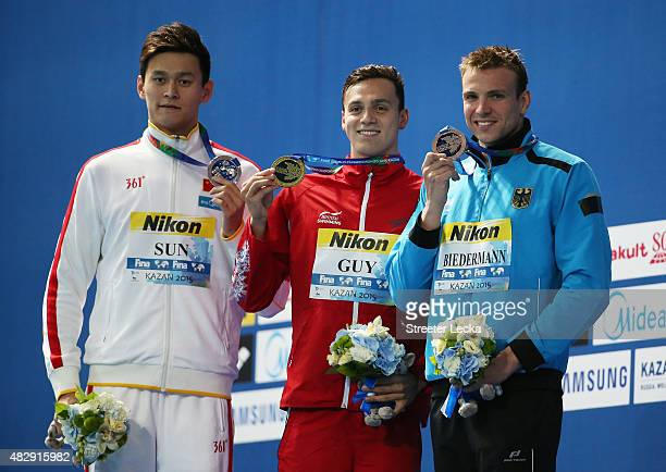 Gold medallist James Guy of Great Britain poses with silver medallist Yang Sun of China and bronze medallist Paul Biedermann of Germany during the...