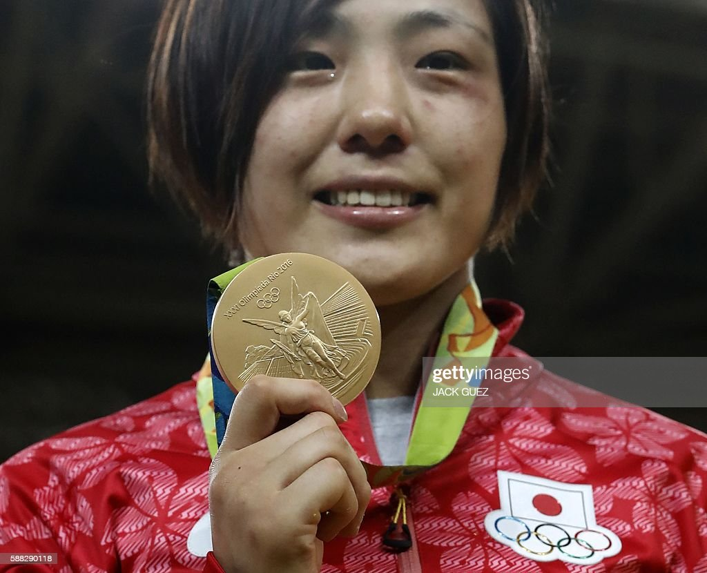 Gold medallist Japan's Haruka Tachimoto celebrates on the podium of the women's -70kg judo contest of the Rio 2016 Olympic Games in Rio de Janeiro on August 10, 2016. / AFP / Jack GUEZ