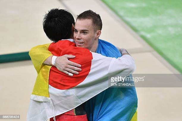 Gold medallist Japan's Kohei Uchimura celebrates with silver medallist Ukraine's Oleg Verniaiev after the men's individual all-around final of the...