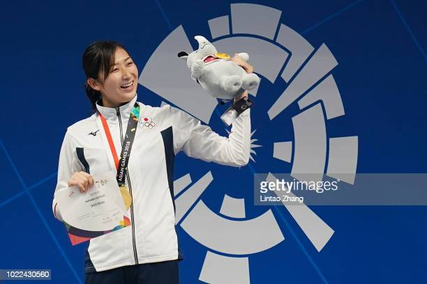 Gold medallist Japan's Rikako Ikee celebrates during the victory ceremony for the womens 50m freestyle swimming event on day six of the Asian Games...