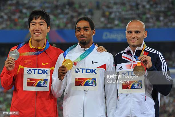 Gold medallist Jason Richardson of the US poses with silver medallist Liu Xiang of China and bronze medallist Andrew Turner of Britain during the...