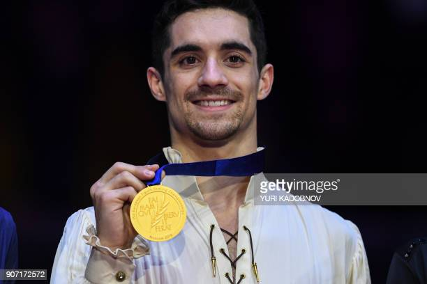 Gold medallist Javier Fernandez poses with his medal after the men's free skating at the ISU European Figure Skating Championships in Moscow on...