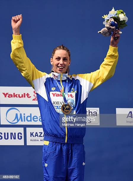 Gold medallist Jennie Johansson of Sweden celebrates during the medal ceremony for the Women's 50m Breaststroke Final on day sixteen of the 16th FINA...