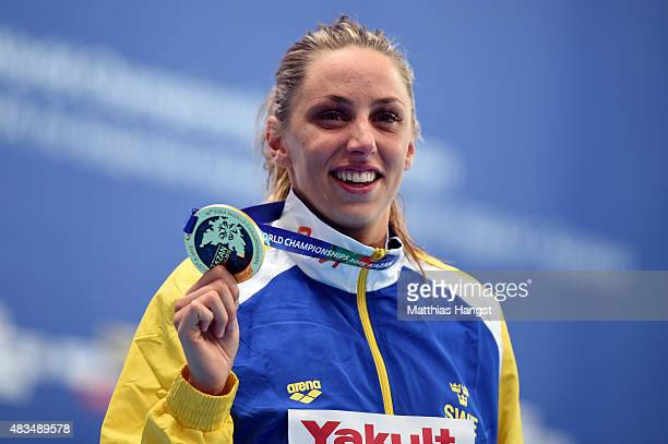 Gold medallist Jennie Johansson of Sweden poses during the medal ceremony for the Women's 50m Breaststroke Final on day sixteen of the 16th FINA...
