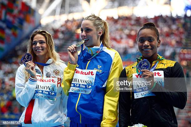 Gold medallist Jennie Johansson of Sweden poses with silver medallist Alia Atkinson of Jamaica and bronze medallist Yuliya Efimova of Russia during...