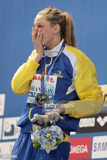 Gold medallist Jennie Johansson of Sweden reacts during the medal ceremony for the Women's 50m Breaststroke Final on day sixteen of the 16th FINA...