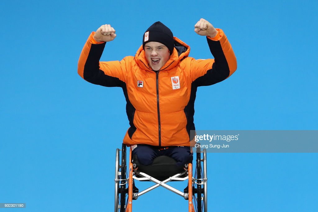 Gold medallist Jeroen Kampschreur of the Netherlands celebrates on the podium during the medal ceremony for the Alpien Skiing Men's Super Combined - Sitting on day six of the PyeongChang 2018 Paralympic Games at the PyeongChang Medals Plaza on March 15, 2018 in Pyeongchang-gun, South Korea.