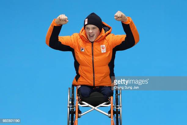 Gold medallist Jeroen Kampschreur of the Netherlands celebrates on the podium during the medal ceremony for the Alpien Skiing Men's Super Combined...