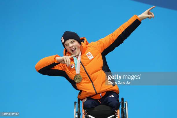 Gold medallist Jeroen Kampschreur of the Netherlands celebrates on the podium during the medal ceremony for the Alpien Skiing Men's Super Combined -...