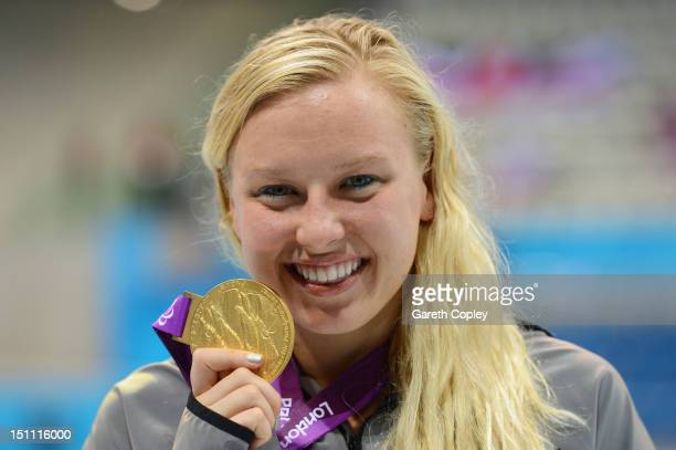 Gold medallist Jessica Long of the United States poses on the podium during the medal ceremony for the Women's 100m Breaststroke - SB7 Finalon day 3...