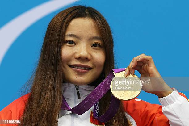 Gold medallist Jiangbo Xia of China poses on the podium during the medal ceremony for the Women's 100m Freestyle S3 finalon day 5 of the London 2012...