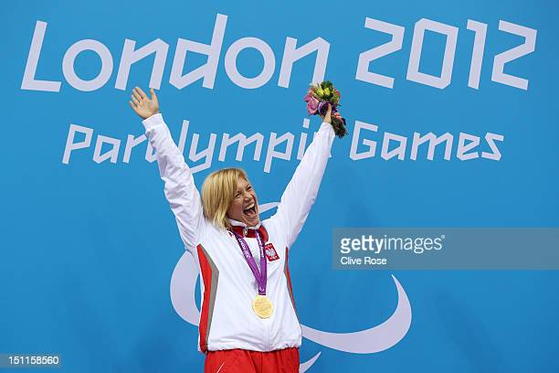 Gold medallist Joanna Mendak of Poland poses on the podium during the medal ceremony for the Women's 100m Butterfly S12 final on day 4 of the London...