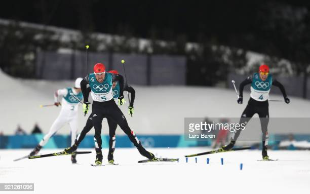Gold medallist Johannes Rydzek of Germany heads for the finish line followed by silver medallist Fabian Riessle of Germany and bronze medallist Eric...
