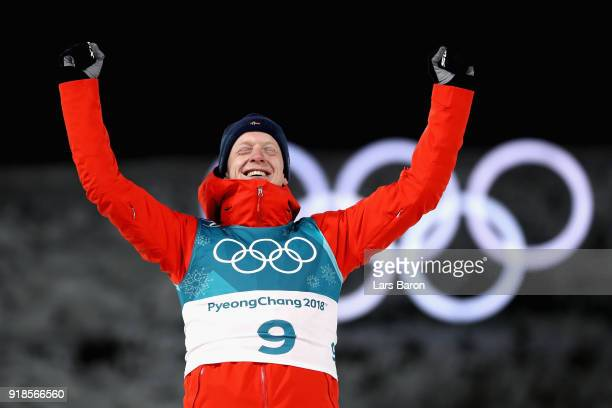 Gold medallist Johannes Thingnes Boe of Norway celebrates during the victory ceremony for the Men's 20km Individual Biathlon at Alpensia Biathlon...