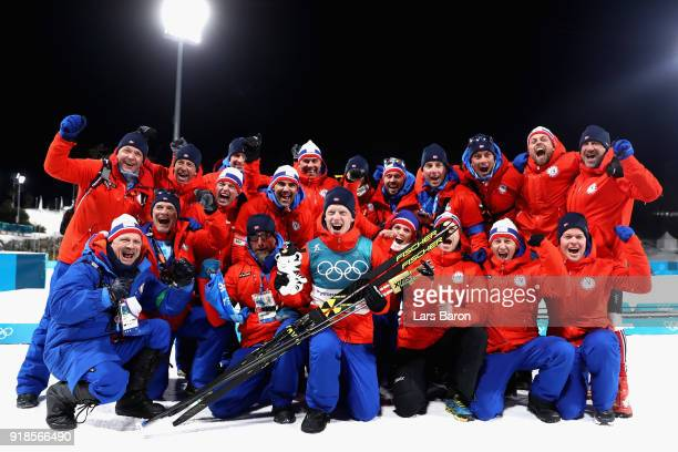 Gold medallist Johannes Thingnes Boe of Norway celebrates with his team during the victory ceremony for the Men's 20km Individual Biathlon at...