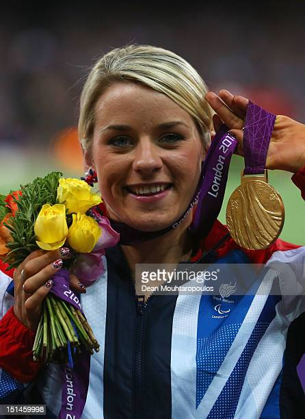 Gold medallist Josie Pearson of Great Britain poses on the podium during the medal ceremony for the Women's Discus Throw F51/52/53 Final on day 9 of...