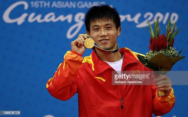 Gold medallist Jungyong Zhang of China in the Men's 65kg Sanshou Wushu during day five of the 16th Asian Games Guangzhou 2010 at Nansha Gymnasium on...