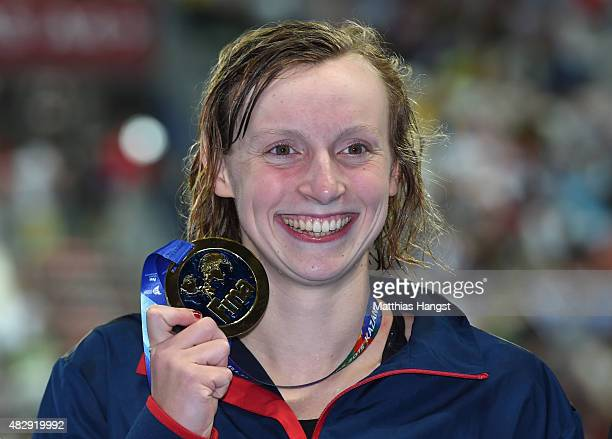 Gold medallist Katie Ledecky of the United States celebrates during the medal ceremony for the Women's 1500m Freestyle Final on day eleven of the...