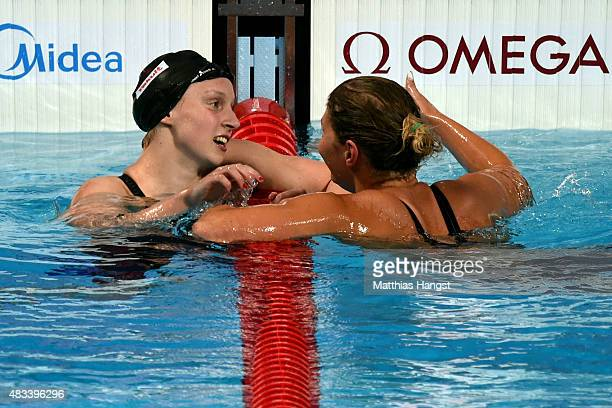 Gold medallist Katie Ledecky of the United States is congratulated by Lotte Friis of Denmark who won in a new world record time of 80739 in the...