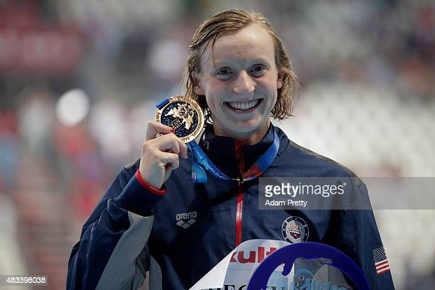 Gold medallist Katie Ledecky of the United States poses during the medal ceremony after setting a new world record of 80739 in the Women's 800m...