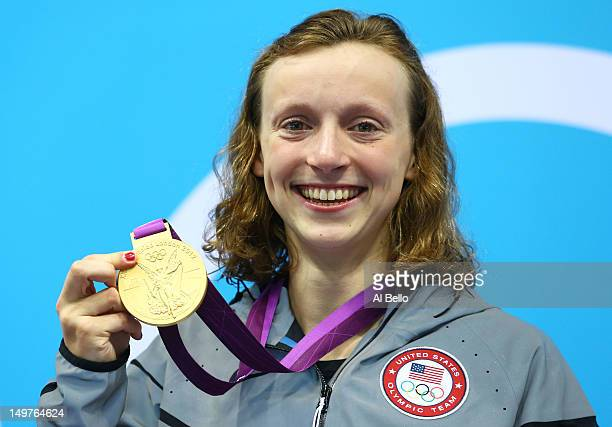 Gold medallist Katie Ledecky of the United States poses on the podium during the medal ceremony for the Women's 800m Freestyle on Day 7 of the London...