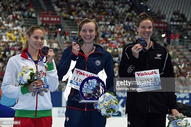 Gold medallist Katie Ledecky of the United States poses with silver medallist Lauren Boyle of New Zealand and bronze medallist Boglarka Kapas of...