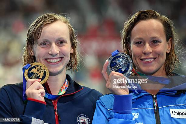 Gold medallist Katie Ledecky of the United States poses with silver medallist Federica Pellegrini of Italy during the medal ceremony for the Women's...