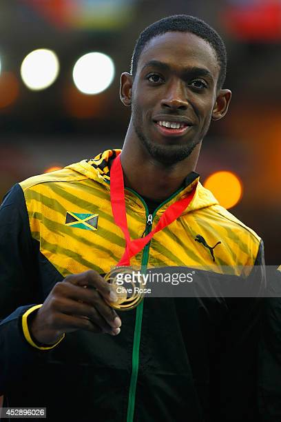 Gold medallist Kemar BaileyCole of Jamaica poses on the podium during the medal ceremony for the Men's 100 metres at Hampden Park during day six of...