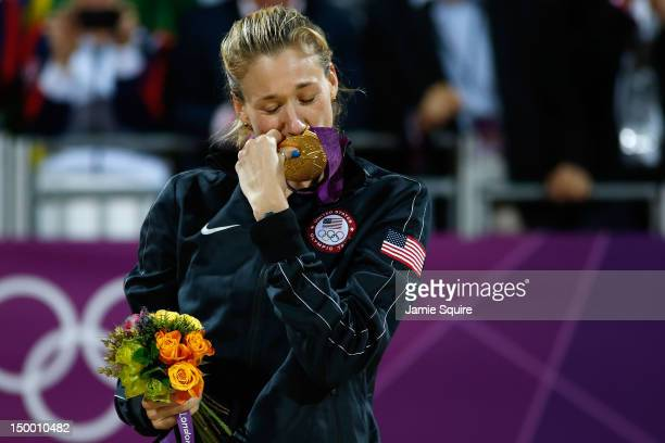 Gold medallist Kerri Walsh Jennings of the United States celebrates winning the Gold medal during the medal ceremony for the Women's Beach Volleyball...