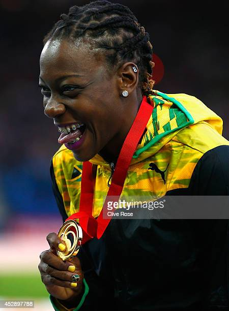 Gold medallist Kimberly Williams of Jamaica poses on the podium during the medal ceremony for the Women's Triple Jump at Hampden Park during day six...