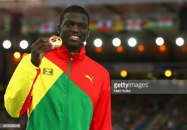 Gold medallist Kirani James of Grenada aon the podium during the medal ceremony for the Men's 400 metres at Hampden Park during day seven of the...