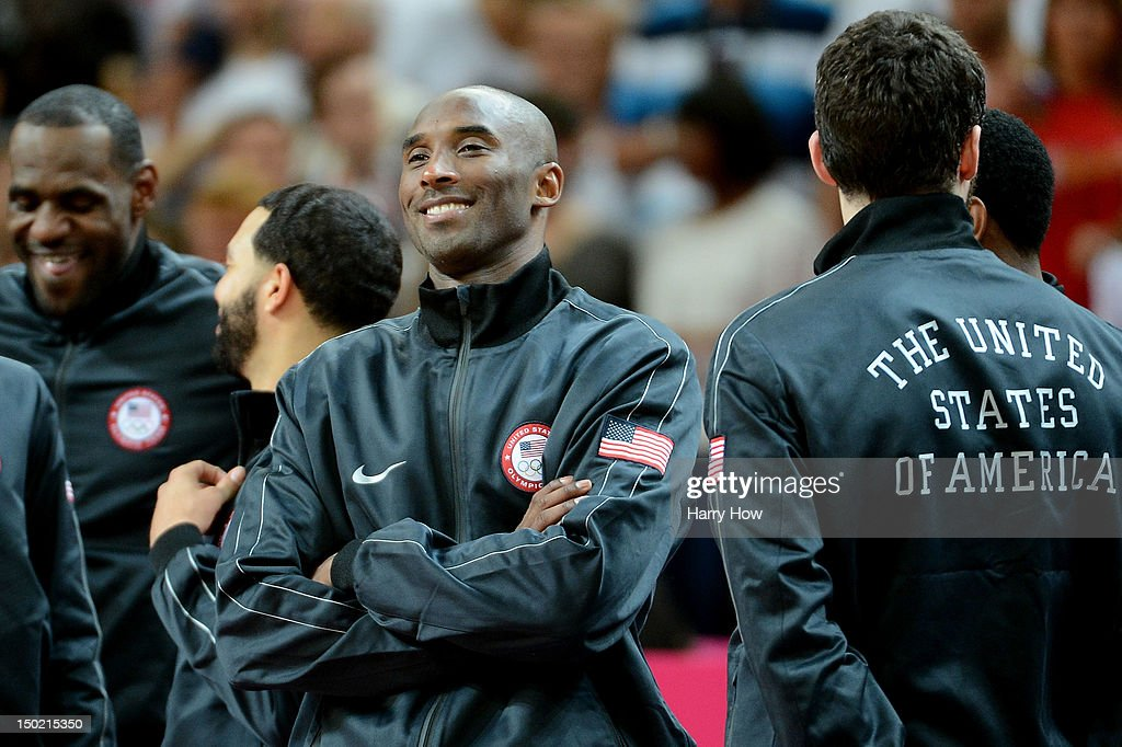 Gold medallist Kobe Bryant #10 of the United States looks on from the podium during the medal ceremony for the Men's Basketball on Day 16 of the London 2012 Olympics Games at North Greenwich Arena on August 12, 2012 in London, England.