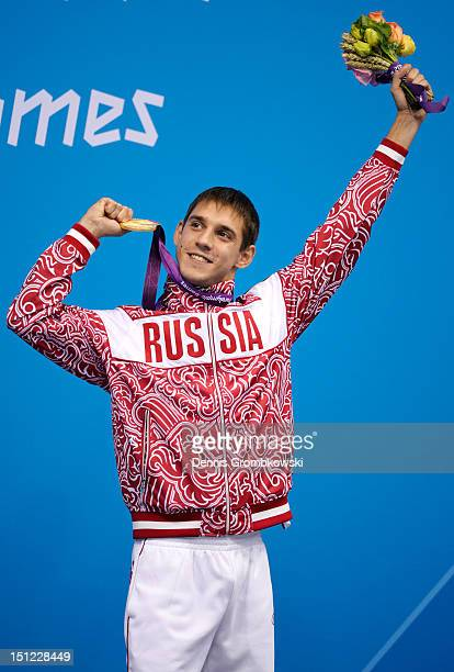 Gold medallist Konstantin Lisenkov of Russia poses on the podium during the medal ceremony for the Men's 100m Backstroke S8 final on day 6 of the...