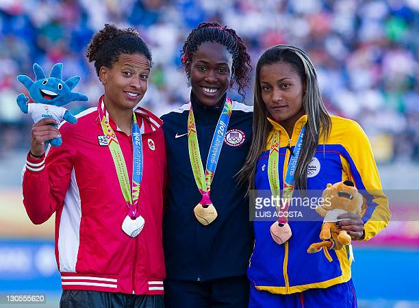 US Gold medallist Kristine Lewis Canada's Silver medallist Angela Waite and Colombian Bronze medallist Lina Flores celebrate after the 100m Hurdles...
