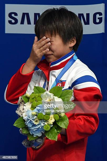 Gold medallist Kuk Hyang Kim of Democratic People's Republic of Korea wipes away tears during the medal ceremony in the Women's 10m Platform Diving...