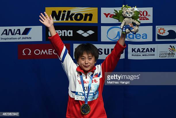 Gold medallist Kuk Hyang Kim of Democratic People's Republic of Korea celebrates during the medal ceremony in the Women's 10m Platform Diving Final...