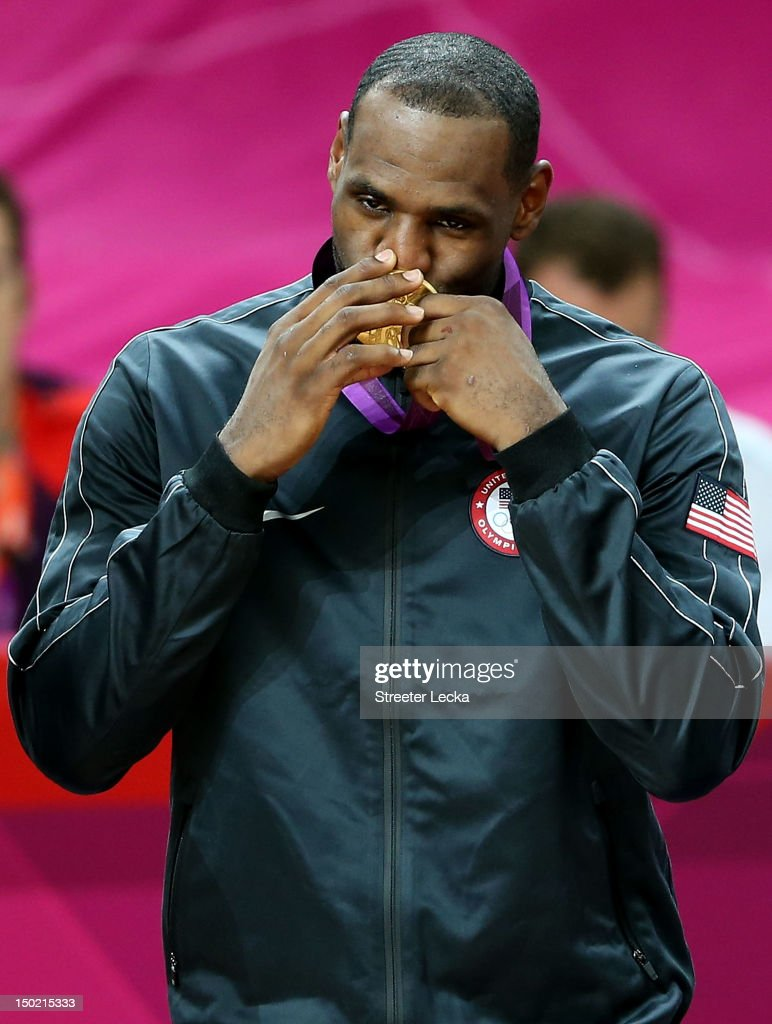 Gold medallist LeBron James #6 of the United States celebrates on the podium during the medal ceremony for the Men's Basketball on Day 16 of the London 2012 Olympics Games at North Greenwich Arena on August 12, 2012 in London, England.